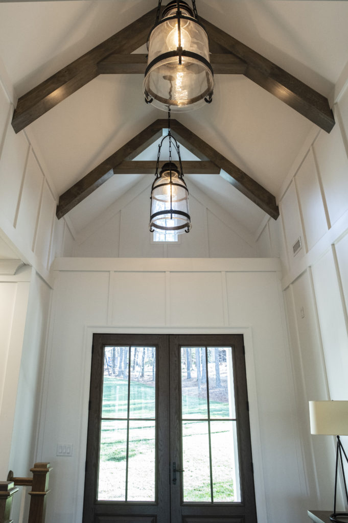 entry with high ceilings wood beams